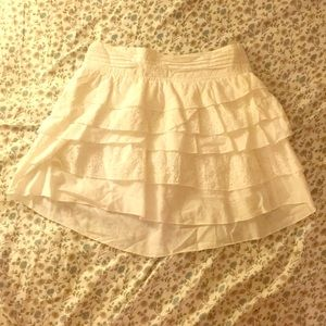 White layered skirt with floral detailing